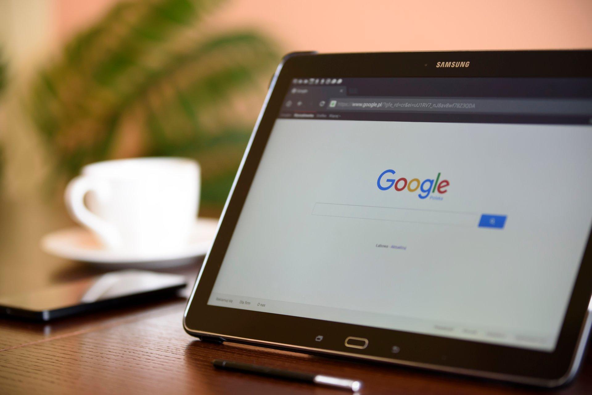 laptop showing Google website